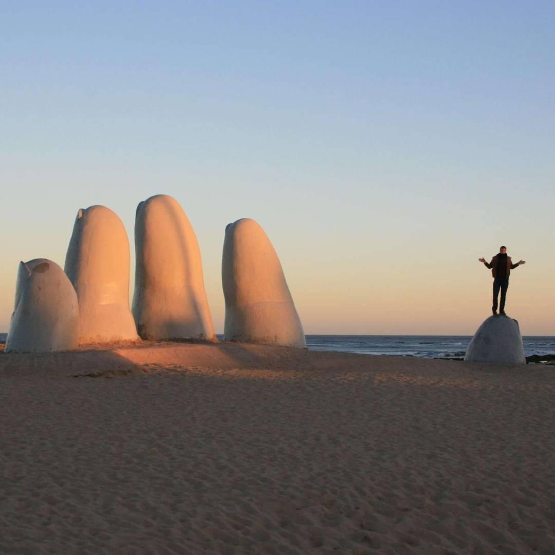 Custom-Travel-Planner-Network-10-Uruguay-Big-Hand-on-Beach
