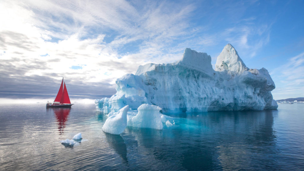 Custom Travel Planner Network-Greenland-Red Sailboat among Glaciers
