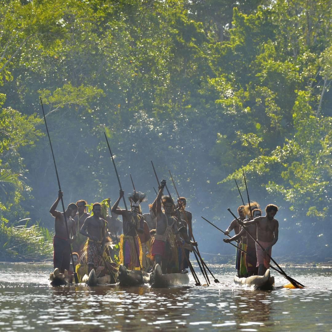 Custom-Travel-Planner-Network-5-Papua-Canoe-War-Asmat