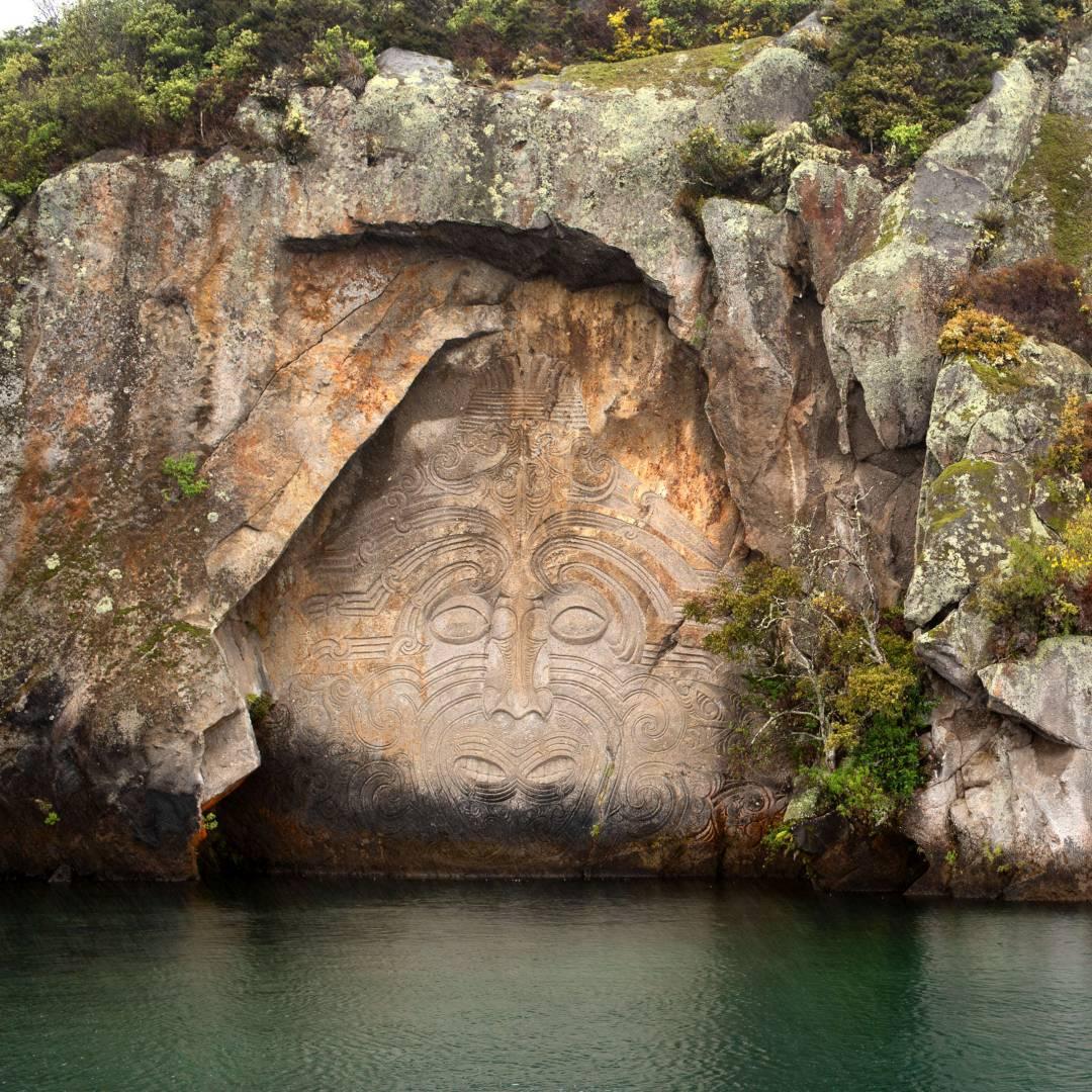Custom-Travel-Planner-Network-8-New-Zealand-Mine-Bay-carvings